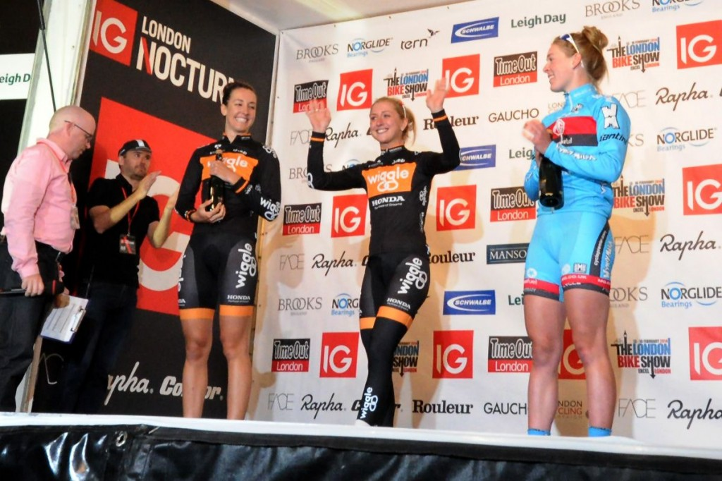 Laura Trott celebrating her win in last year's women's event - a decision later overturned in favour of Hannah Barnes (right)