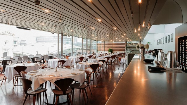 The bright and airy Top Floor Restaurant at SMITHS of Smithfield has great over-rooftop views across to St Pauls and beyond. Photo credit Tom Griffiths