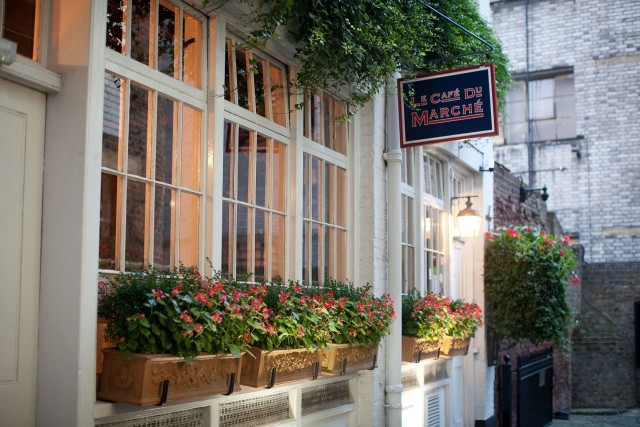 The Cafe du Marche is accessed down a narrow alley next to the Malmaison hotel