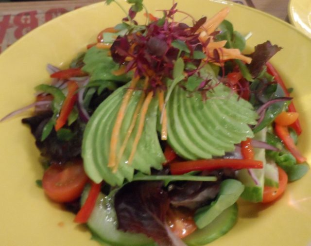The beautifully-presented salad with sliced avocado