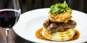 Davy's angers and mash with Madeira gravy and homemade onion rings £12.50/£13.95