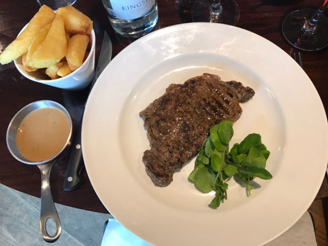 Sirloin (220g, aged for 28 days) including hand cut triple cooked chips (£21.95) with Green Peppercorn sauce (£2.00)